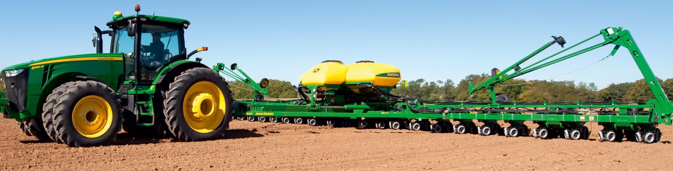 John Deere 8r Series Tractor and 1795NT Planter in the field