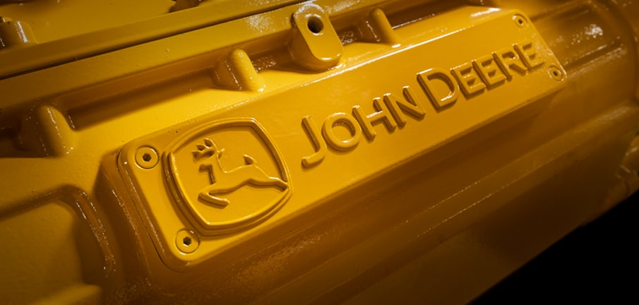 Close up of the John Deere logo on an engine block