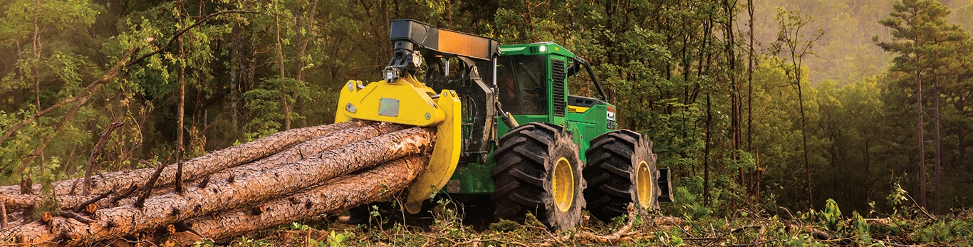 Grapple skidder hauling a load of logs