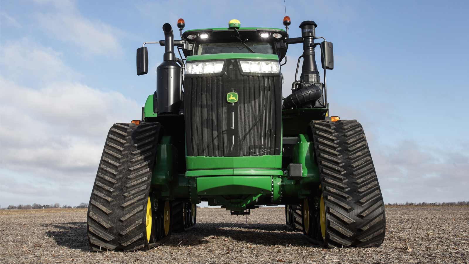 Front view of a 9R Series tractor in a field