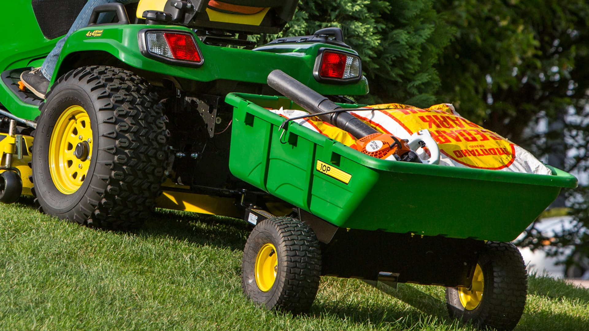 Ride on mower cart attachment for haulage