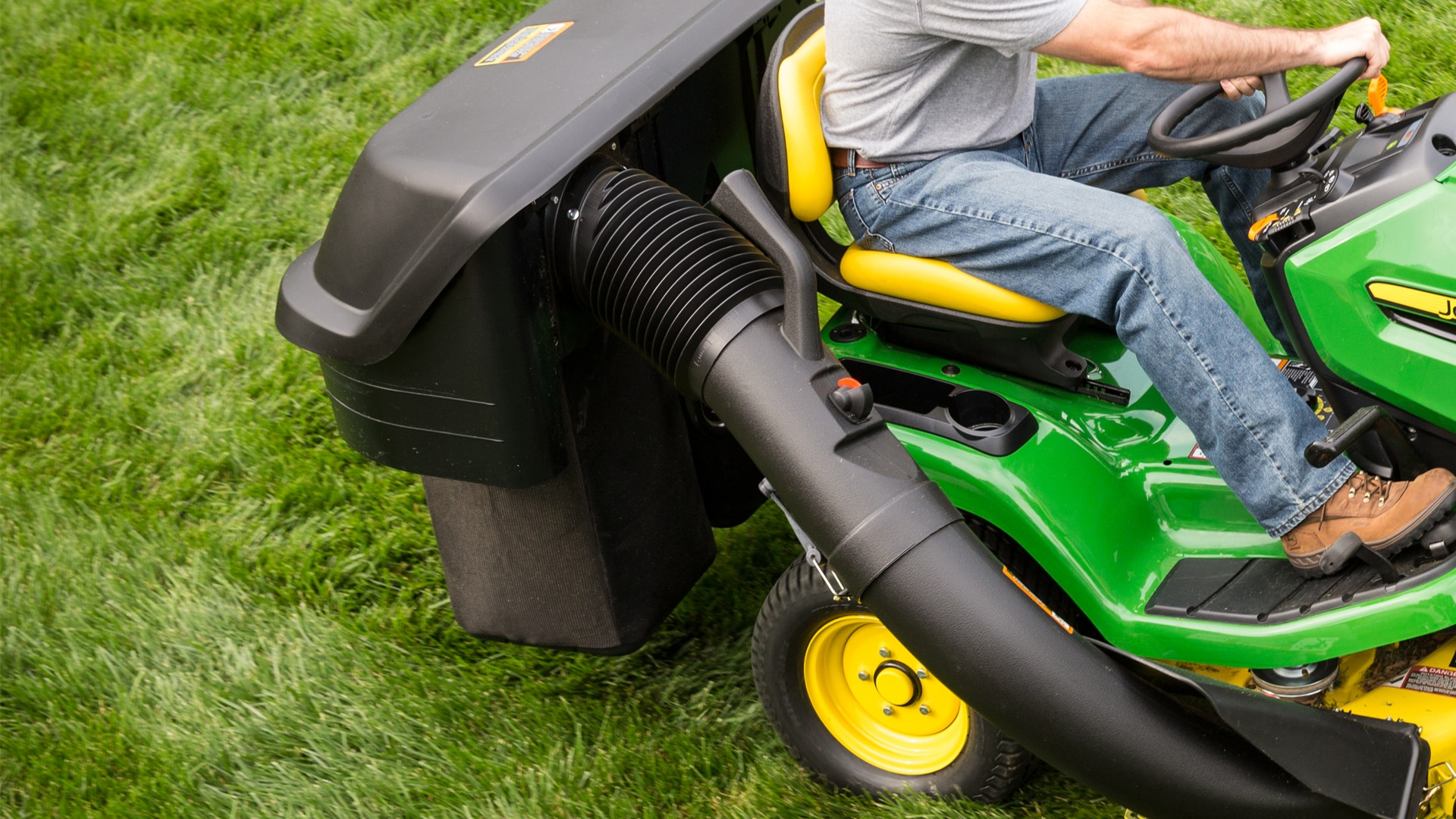 image of bagger system attached to lawn tractor
