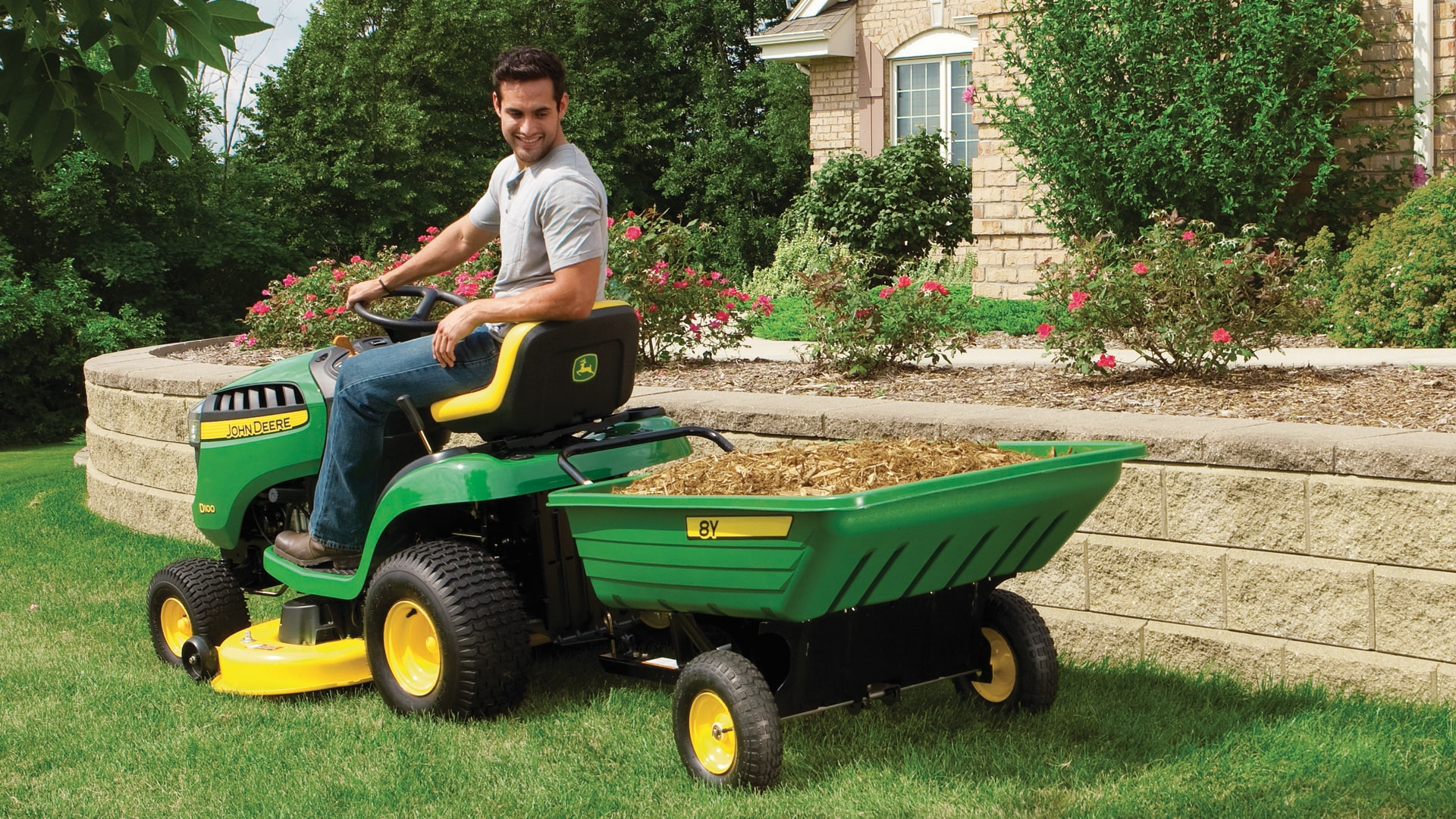 image of cart attached to lawn tractor