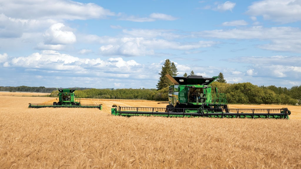 X-Series Combine Harvester moving through crops