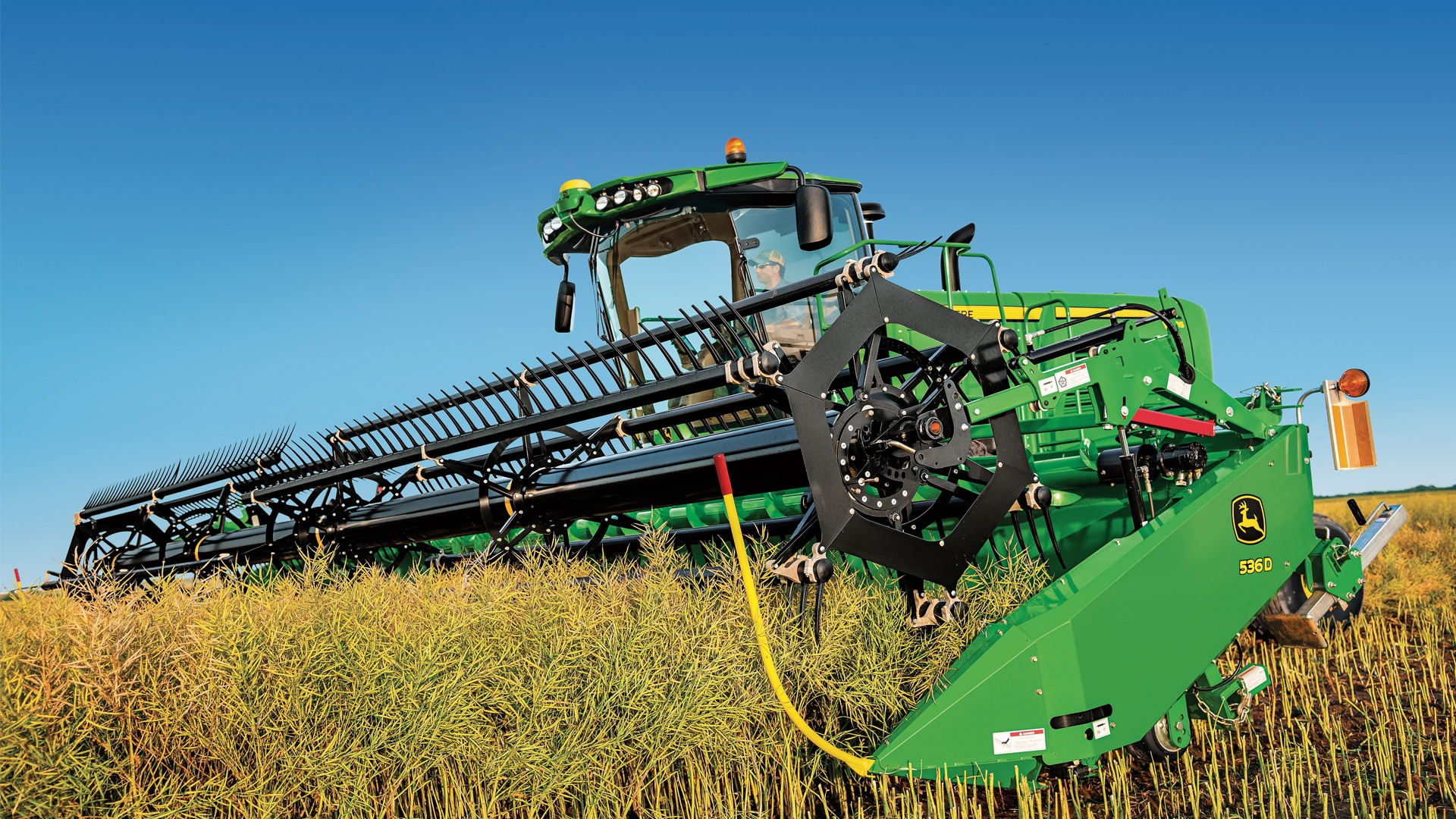 Photo of windrower moving through field