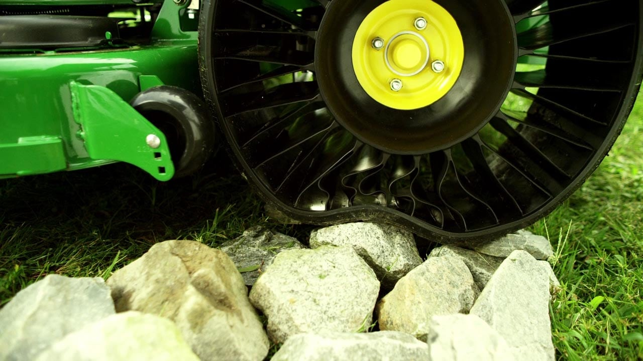 Airless radial tire for heavy-duty lawn care applications