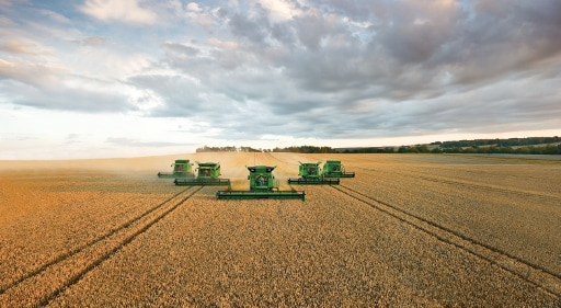 agriculture financing harvesters in a field